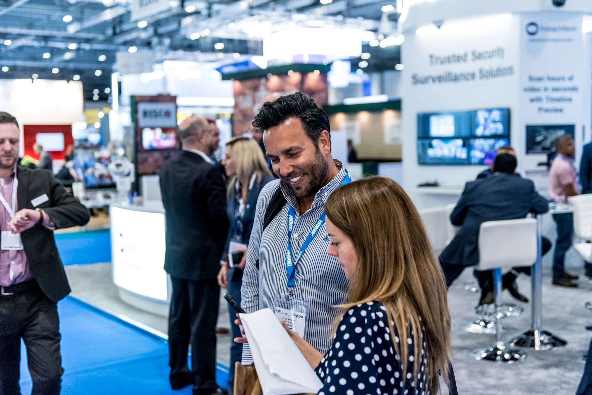 Two visitors networking at IFSEC 2019