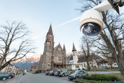 CCTV Camera Operating with church in background