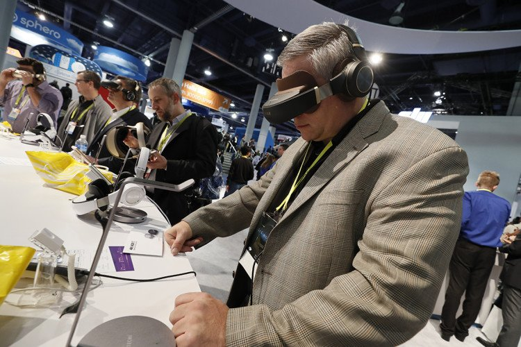 Visitors to CES 2017 in Las Vegas test out some VR headsets